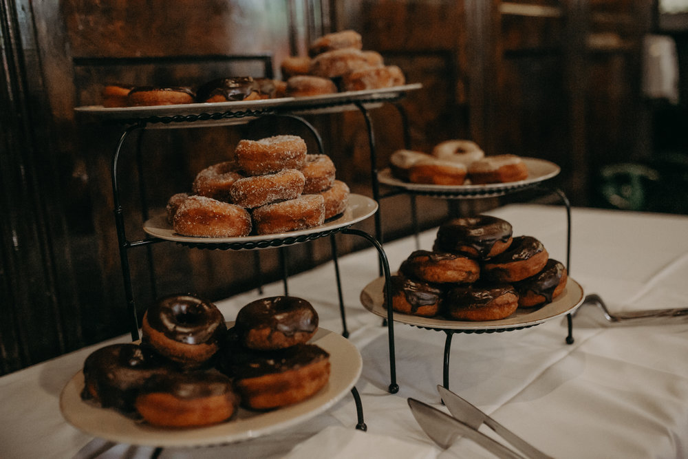 A donut table is set up at Sweeney's Saloon for a wedding reception