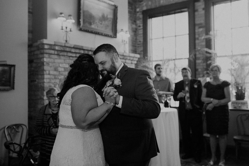 A couple enjoys their first dance in the Fireside Room of W.A. Frost after their wedding ceremony