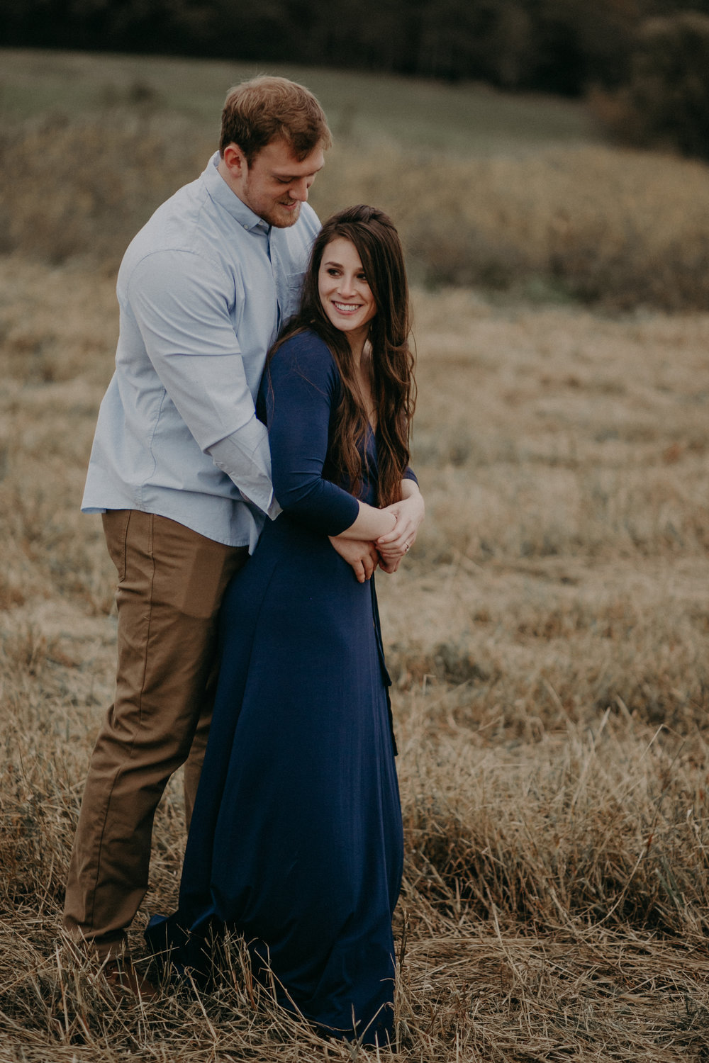 A Hastings MN engagement session in a field overlooking the St Croix River