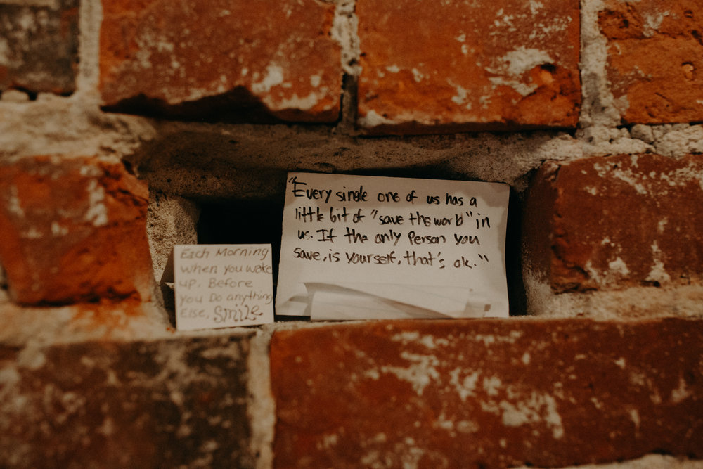 a love note hidden in the wall at Revolution Coffee