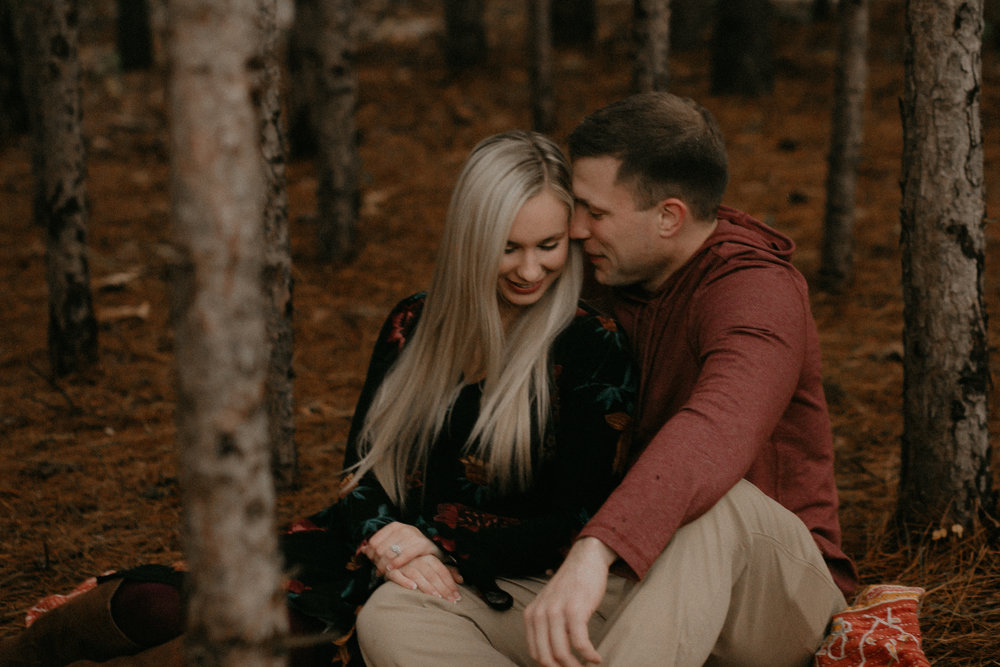 Andrea Wagner Photography captures a candid happy moment during an engagement session at Burlap and Bells in Wisconsin
