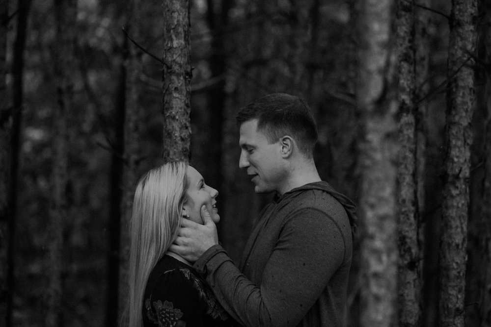 a black and white photo of a couple looking at each other and preparing to kiss at Burlap and Bells