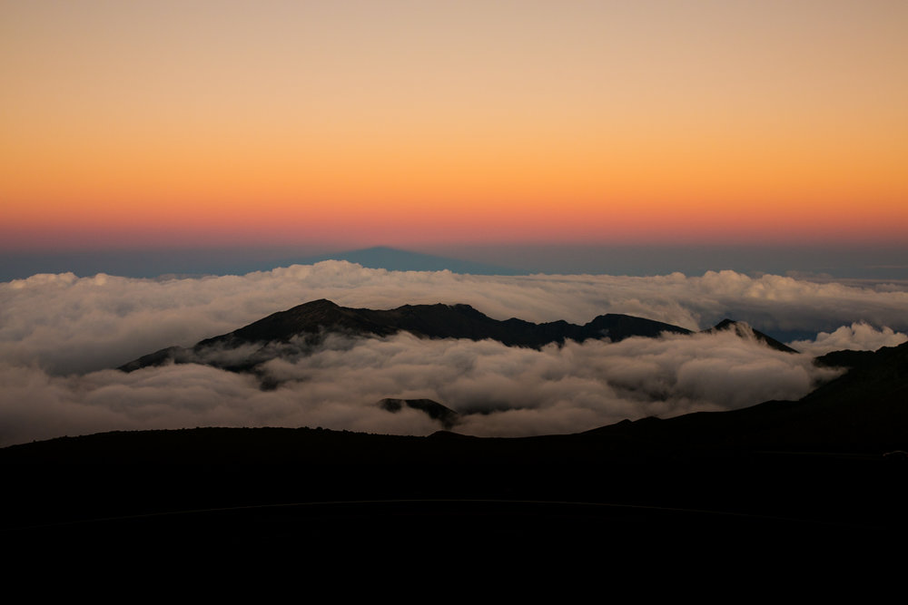 pink and orange sunset above the clouds over Haleakala Crater