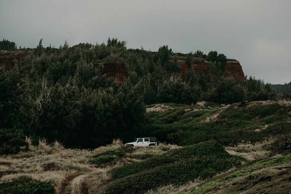 a white jeep parked on cliffs of western Maui Hawaii in iconic photo by Andrea Wagner Photography