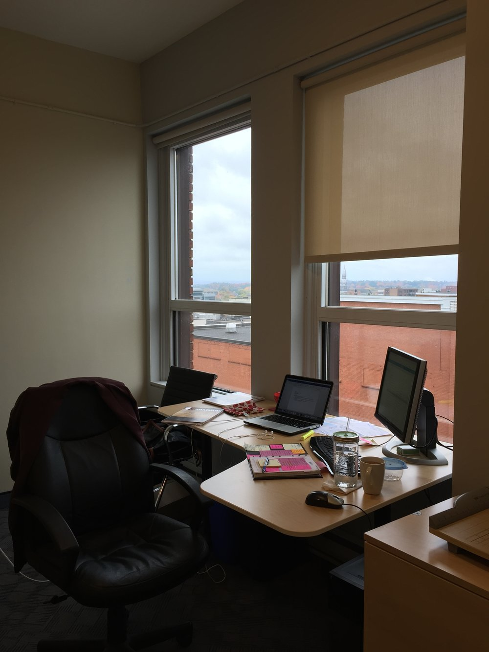 My desk...note the Gatineau parkway colours in the back window and my vast array of sticky notes. Do not note the seemingly cluttered desk.