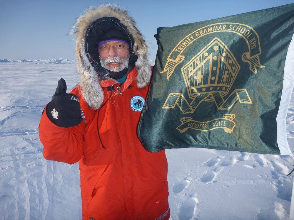 Rob Rigato planting the Trinity flag at the North Pole