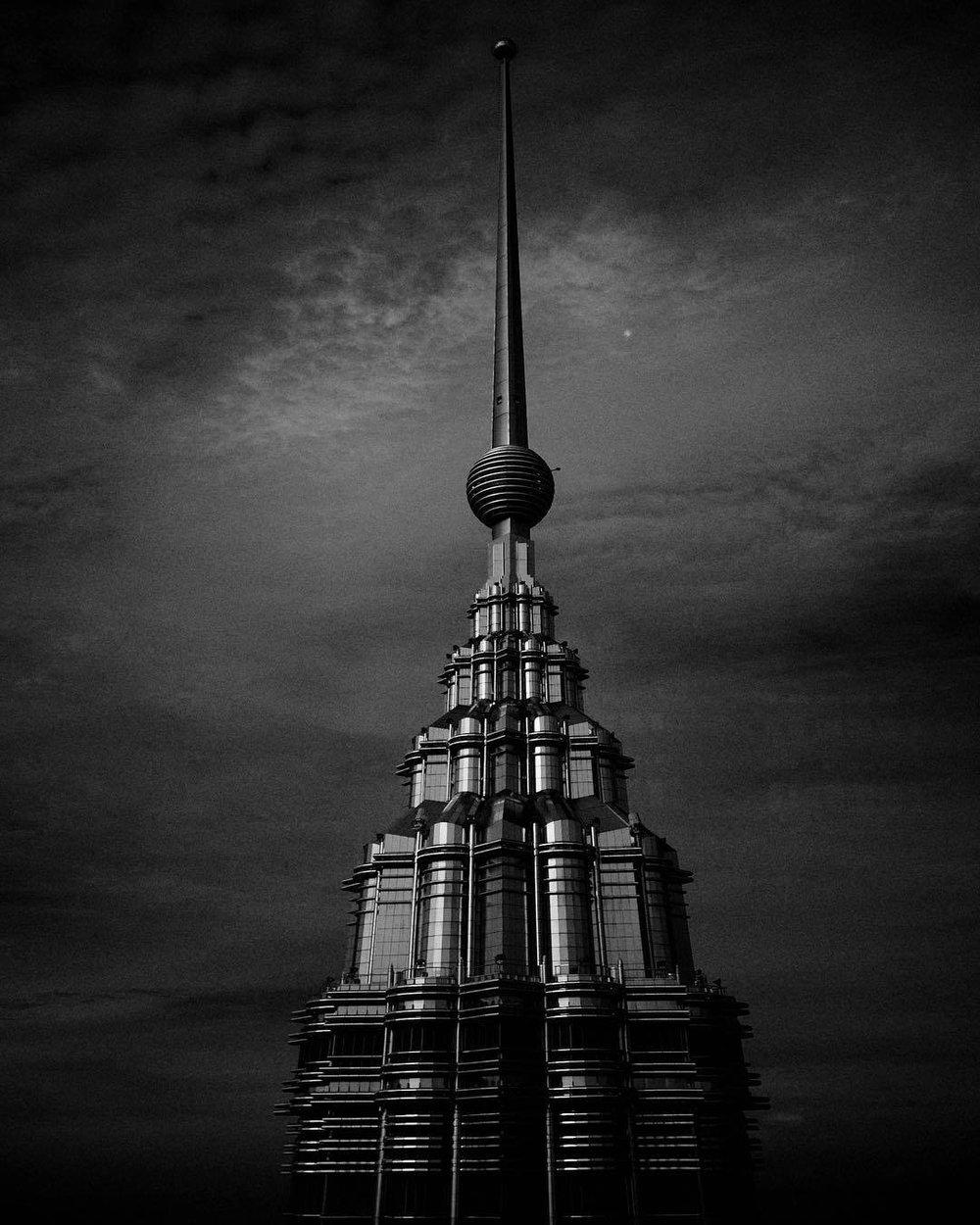 Architecture. Petronas tower. #blackandwhite #architecture #architecturephotography #blackandwhitephoto #petronas #petronastower #cloudysky #malasyia #asia #southasia #asean #bulding #postmodernism #micro43rds #microfourthirds #olympus #olympuspen #penf #lumixlens  (at PETRONAS Twin Towers)