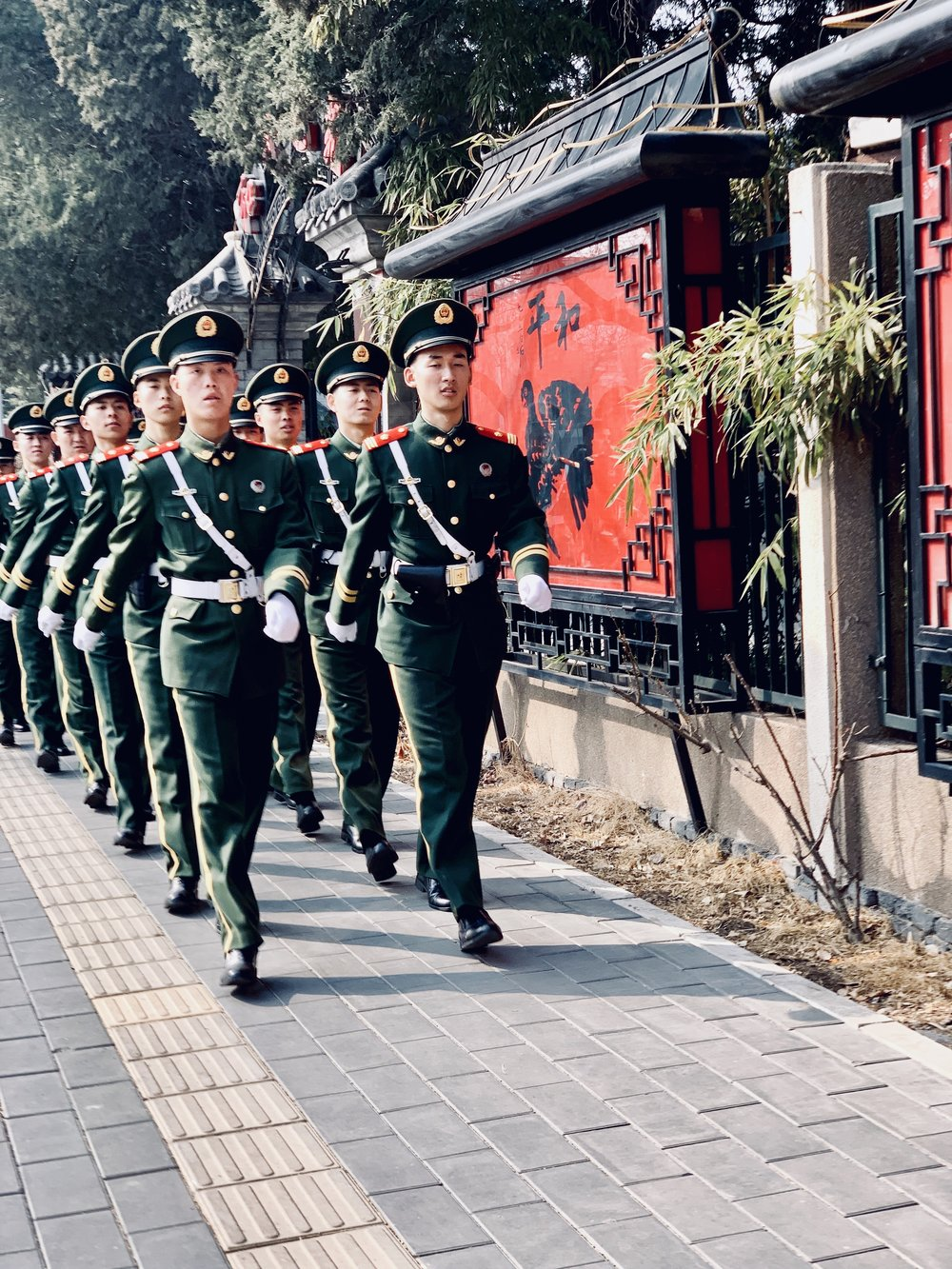 Soldiers of the People's Liberation Army marches near Ritan Park in Beijing