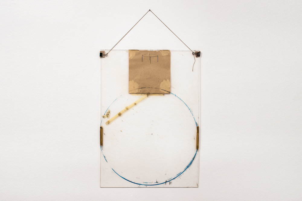 Nahum Tevet, Untitled #30, 1975. Paper, binder clips, twine, transparent tape, masking tape, pencil, marker, and wax pencil on Plexiglas, Plexiglas: 27 3/4 x 20 x 7/16 in. (70.49 x 50.8 x 1.1 cm), Installed: 35 5/8 x 20 x 7/16 in. (90.5 x 50.8 x 1.1 cm). Collection of the artist. Photo by Polite Photographic, courtesy of the Hunter College Art Galleries and the artist.