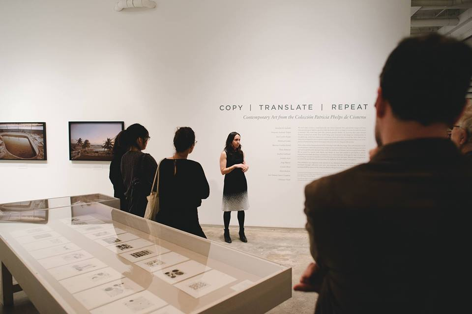 Harper Montgomery leading a tour of  Copy, Translate, Repeat: Contemporary Art from the Colección Patricia Phelps de Cisneros.  Photograph by Natalie Conn.
