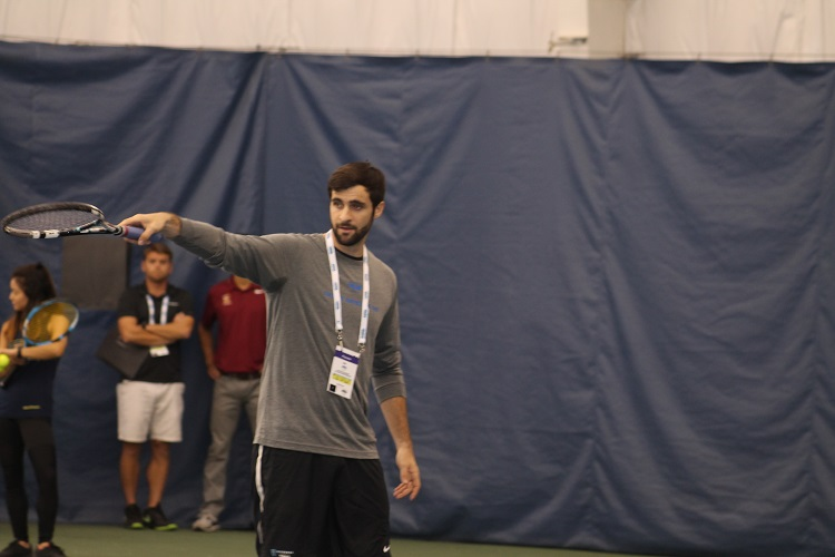 Former Columbia standout and current professional player Max Schnur put on a doubles clinic for the college coaches in attendance.