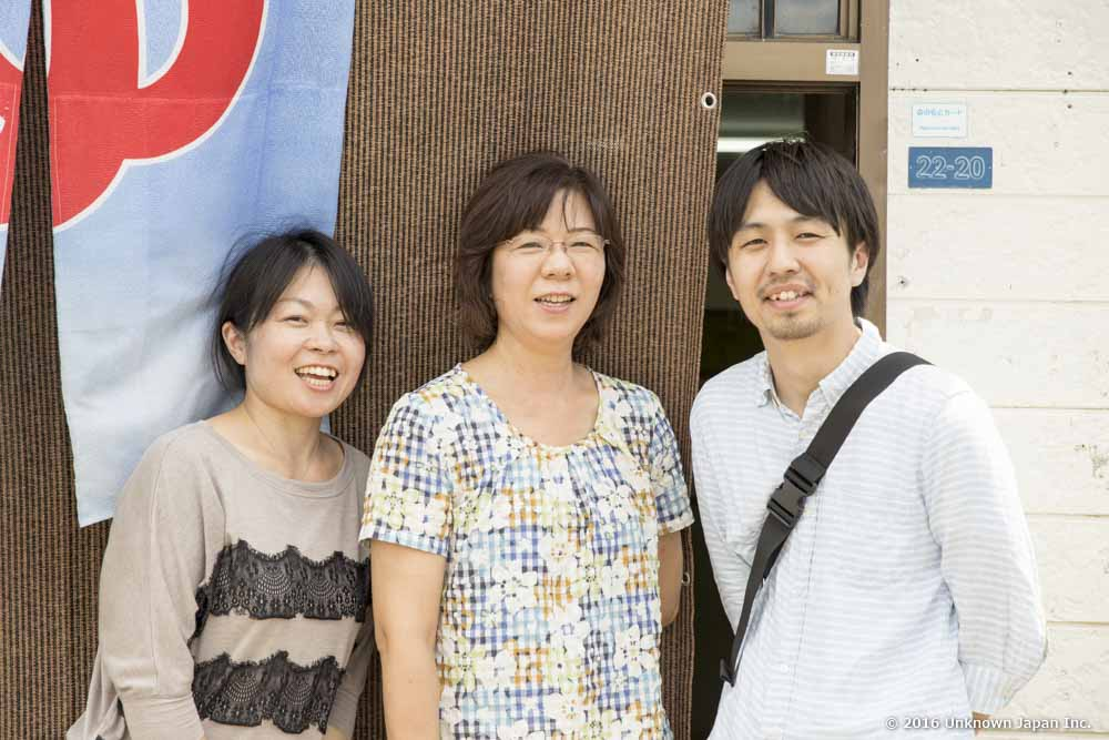 With the manager Masako Tokuda (centre), at the entrance