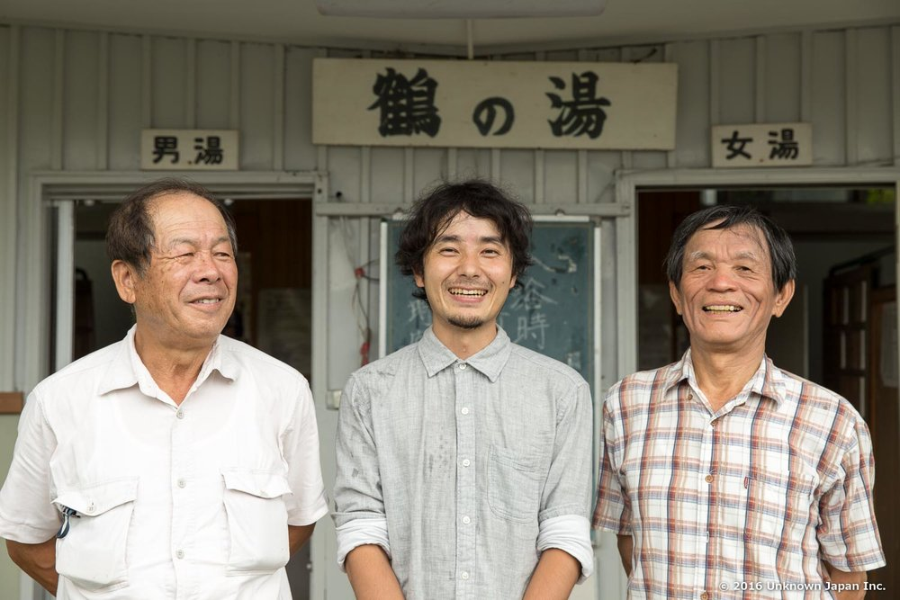 With Okihiro Takahashi and Itsuo Kusadome, shareholders of Tsuru no yu Onsen, in front of the entrance