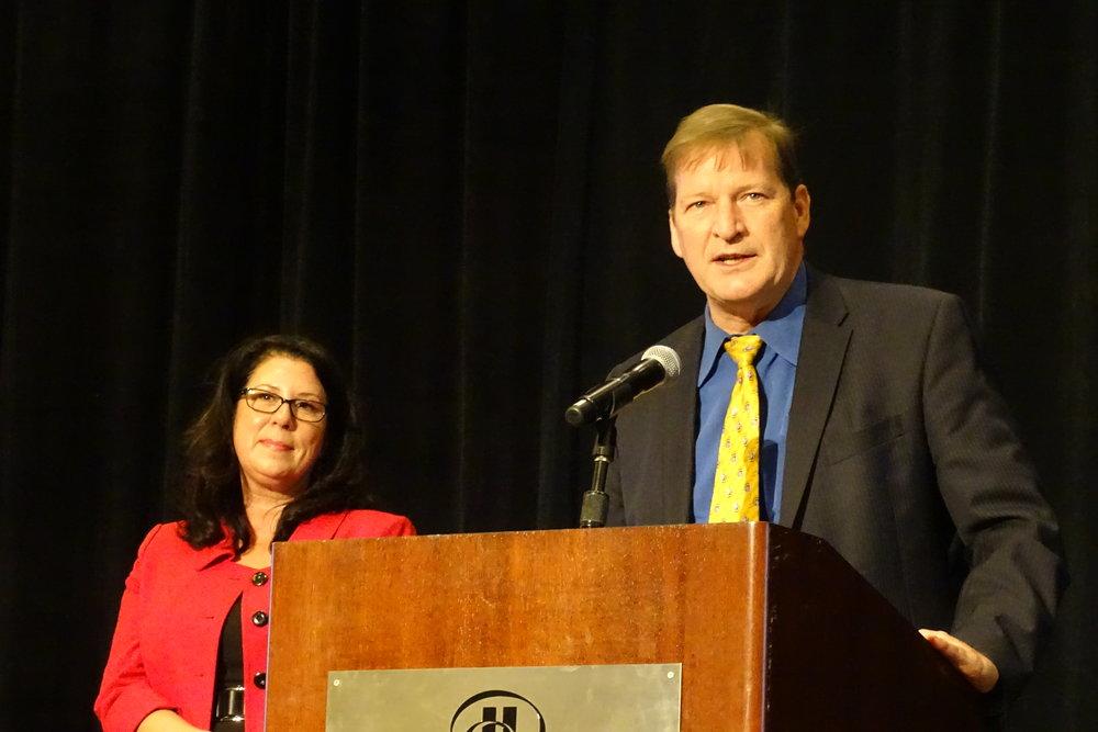 Foundation Board President Deanna Pauli-Hammond & CRMHS CEO Craig Pridemore presenting awards.