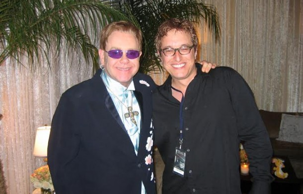 "Adam Chester has worked with  Elton John  and his band since 2005. The band fondly refers to Adam as the  ""Surrogate Elton."""