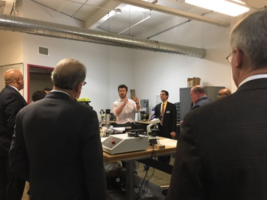 Dr. Kevin White, Chief Operating Officer of Akron Ascent Innovations, gives a demonstration to the Akron City Counsel during a tour of the Akron Global Business Accelerator by the accelerator's CEO Anthony Margida.