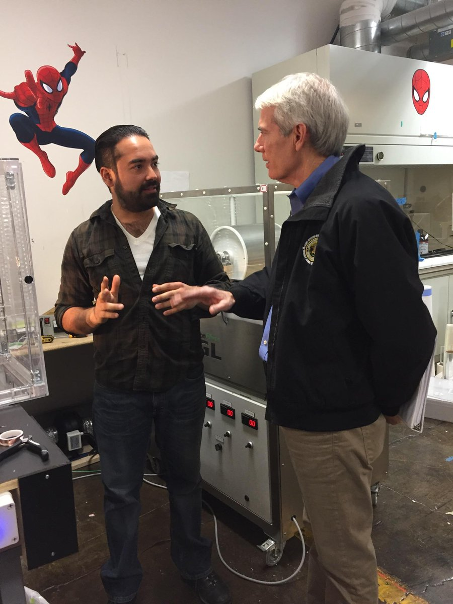 Ali Blandon explaining electrospinning to Senator Rob Portman.
