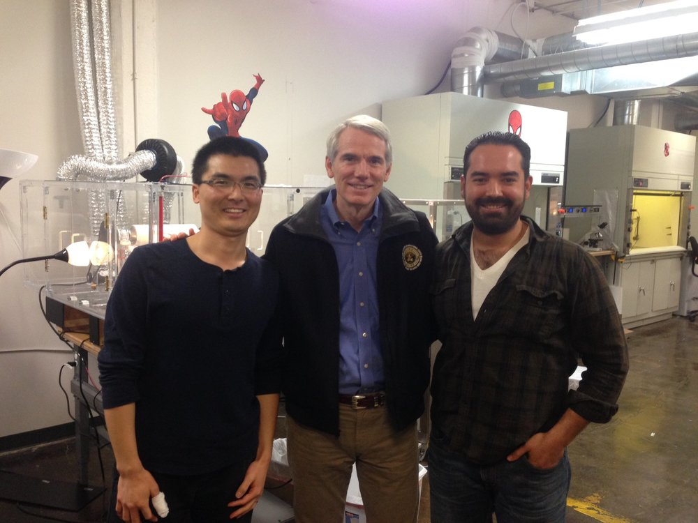 AAI's Dr. Fei Wang and Ali Blandon give Senator Rob Portman a lab tour at the Akron Accelerator.
