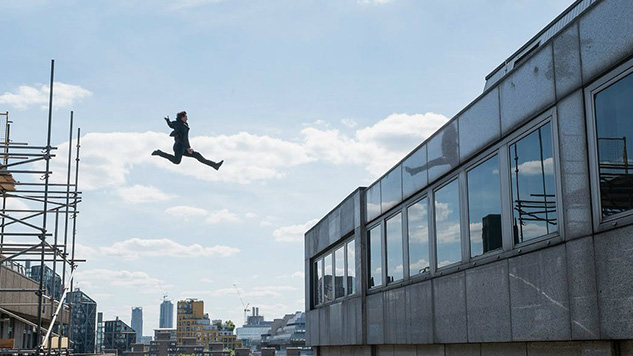 Ethan Hunt (Tom Cruise) leaps buildings in an urban chase sequence in  Mission: Impossible - Fallout . Cruise broke an ankle during the shoot,  delaying production by eight weeks.