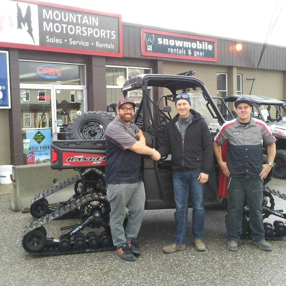 Golden Nordic trail maintenance supervisor, Erwin Perzinger (center) picks up the new Ranger XP from Andrew McBride (left) and Jordan Baun (right) at Mountain Motorsports.