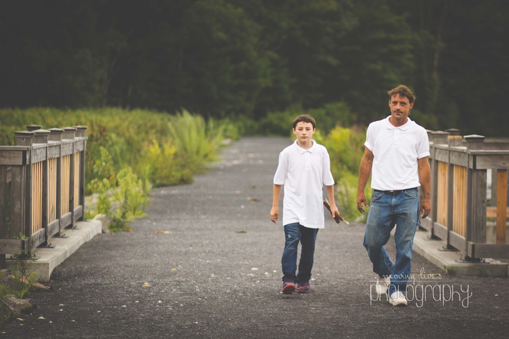 a son and father walks along