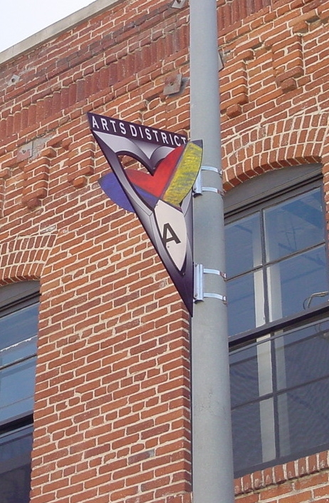 Arts District Medallion, one of 56 inspired by neighborhood history.