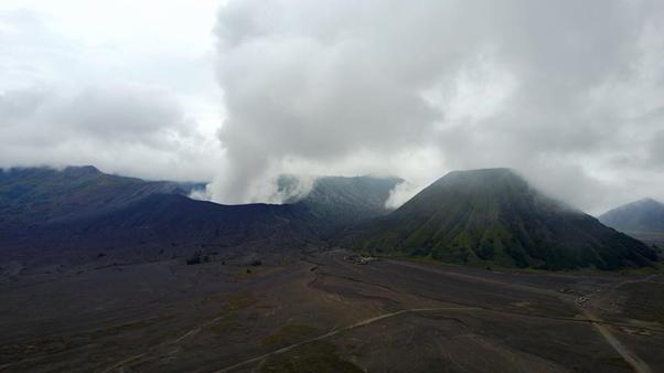 Mount Bromo smoking away on the road to Ijen. Photo: Michael Ishak