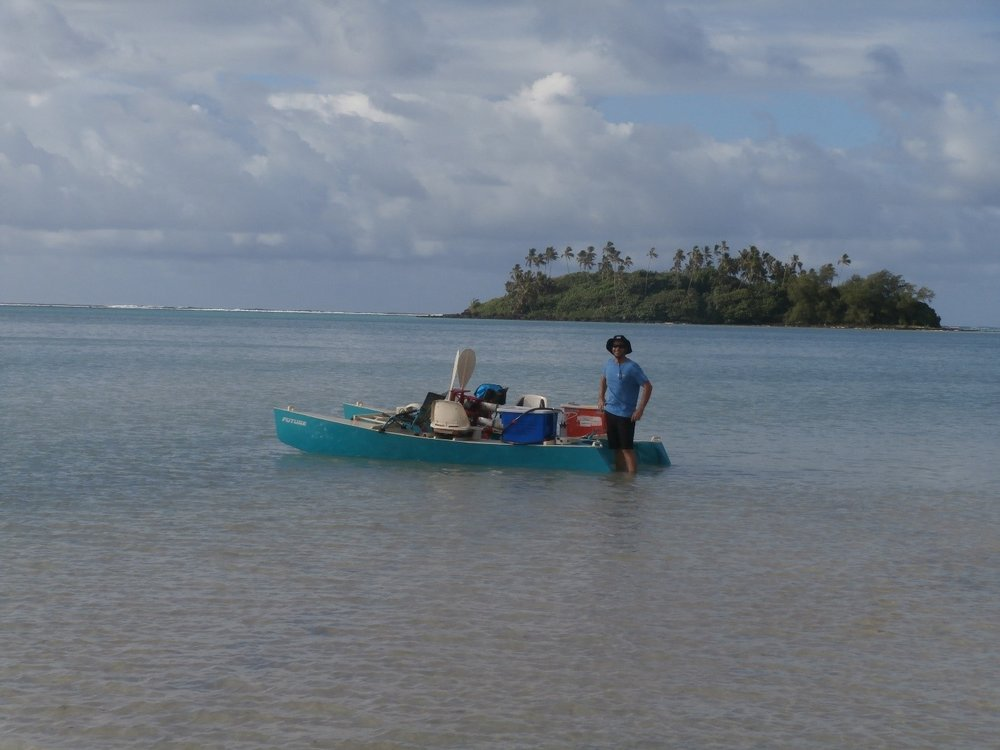 Michael Reading launching the pedal catamaran for a radon, nutrient and GHG spatial survey of the Muri Lagoon.