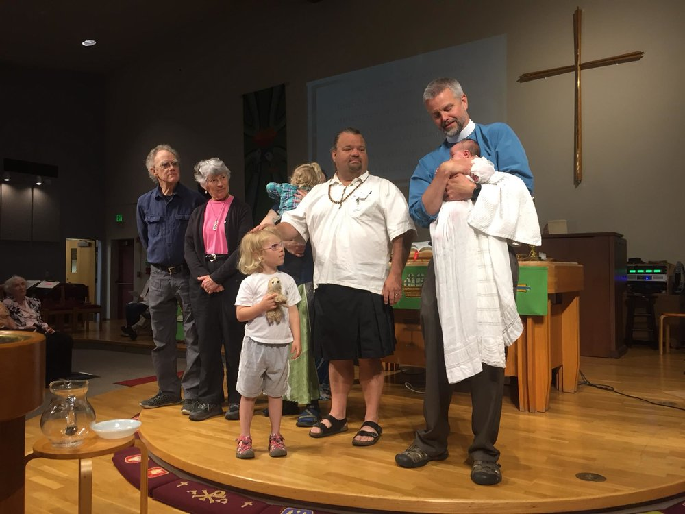 great baptism photo with andy holding baby by family.jpg