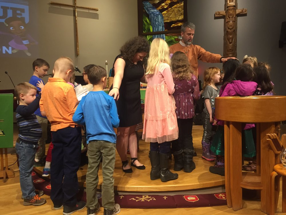 erynne praying with kids and andy.jpg