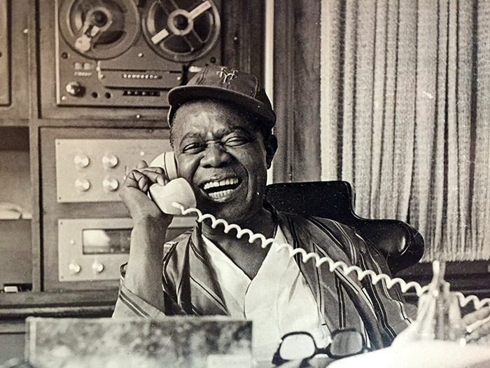 "Louis ""Pops"" Armstrong on the phone at his home in Queens, NY"