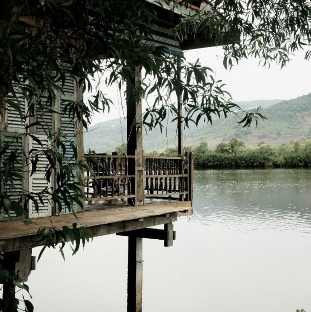 Wooden cottage over the river near Kampot.