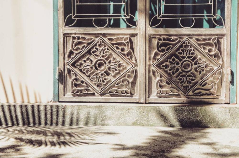 Beautiful door and shadows at a pagoda.