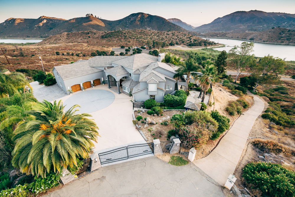 Perched atop 1.5 acres, this 5 bedroom / 7.5 bathroom dream home, offers eternal views of Lake Hodges and its Wildlife Preserve.