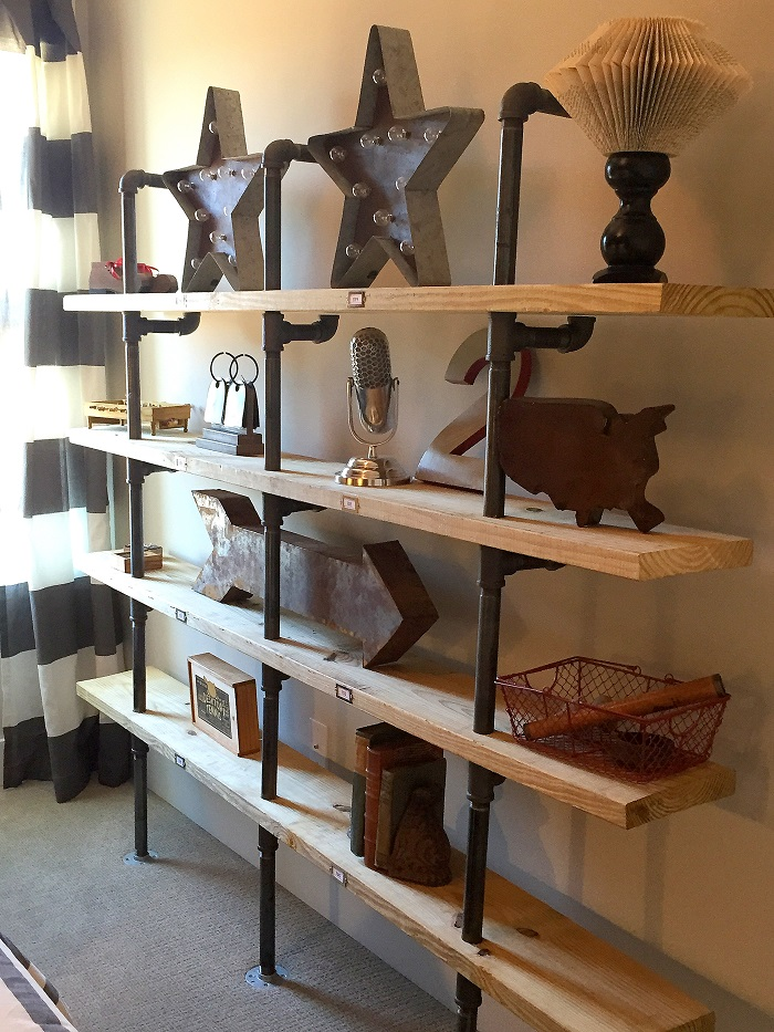 pipes, book shelves, reclaimed boards, industrial chic, boys room shelving