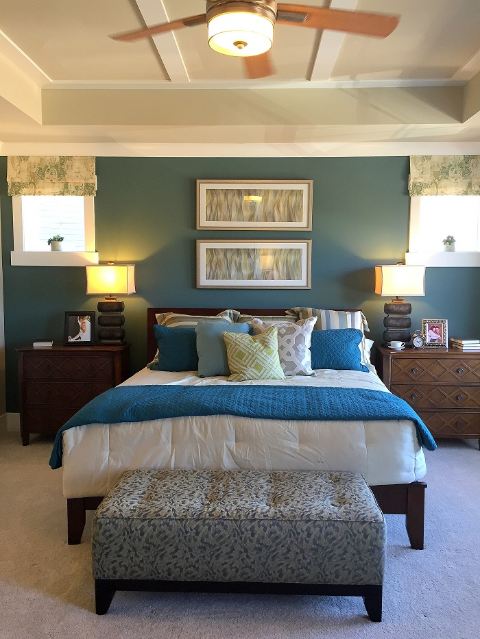 blue master bedroom, small windows, tufted bench, ceiling fan