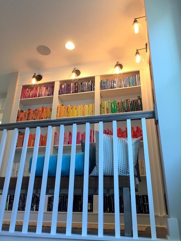 built in bookshelves, color banding, library lighting