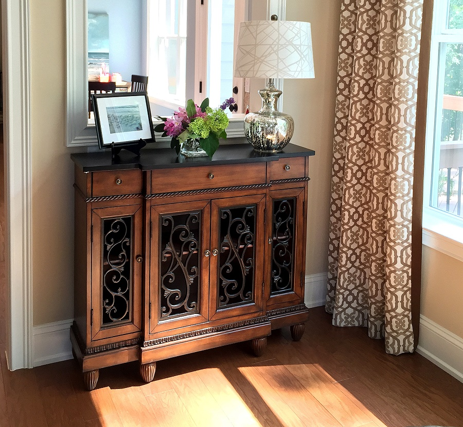 The chest is from Kirklands and the lamp is a Target find!  These gave us more room in the budget for items like custom window treatments (shown) and hand knotted rugs.