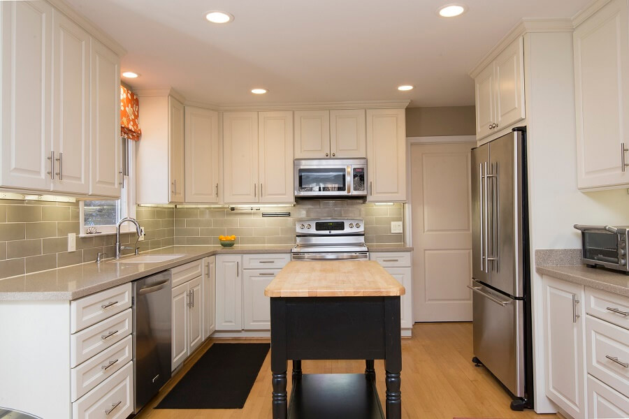 This Kitchen was transformed without changing the footprint or the solid surface counters. New cabinets, tile backsplash, appliances and fresh color palette did the trick at an affordable price.