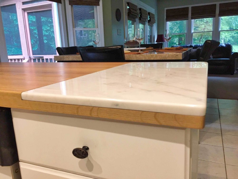 inset-carrera-marble-white-kitchen-raleigh.jpeg