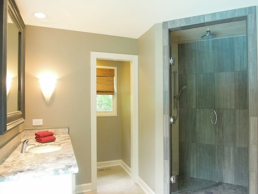 The Master Bath in this Raleigh home was completely remodeled.  Two vanities, separate water closet, freestanding tub and large shower with rain showerhead make it one fabulous room.