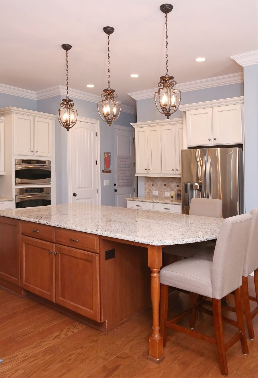By adding new light fixtures over the large granite island and LED bulbs in the recessed cans, this Raleigh Kitchen absolutely sparkles.
