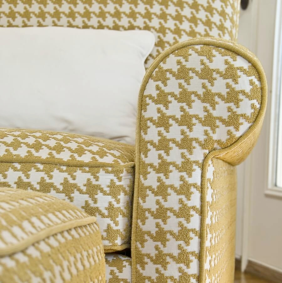 This houndstooth upholstery fabric on an existing club chair brings a smile to all who enter the room.