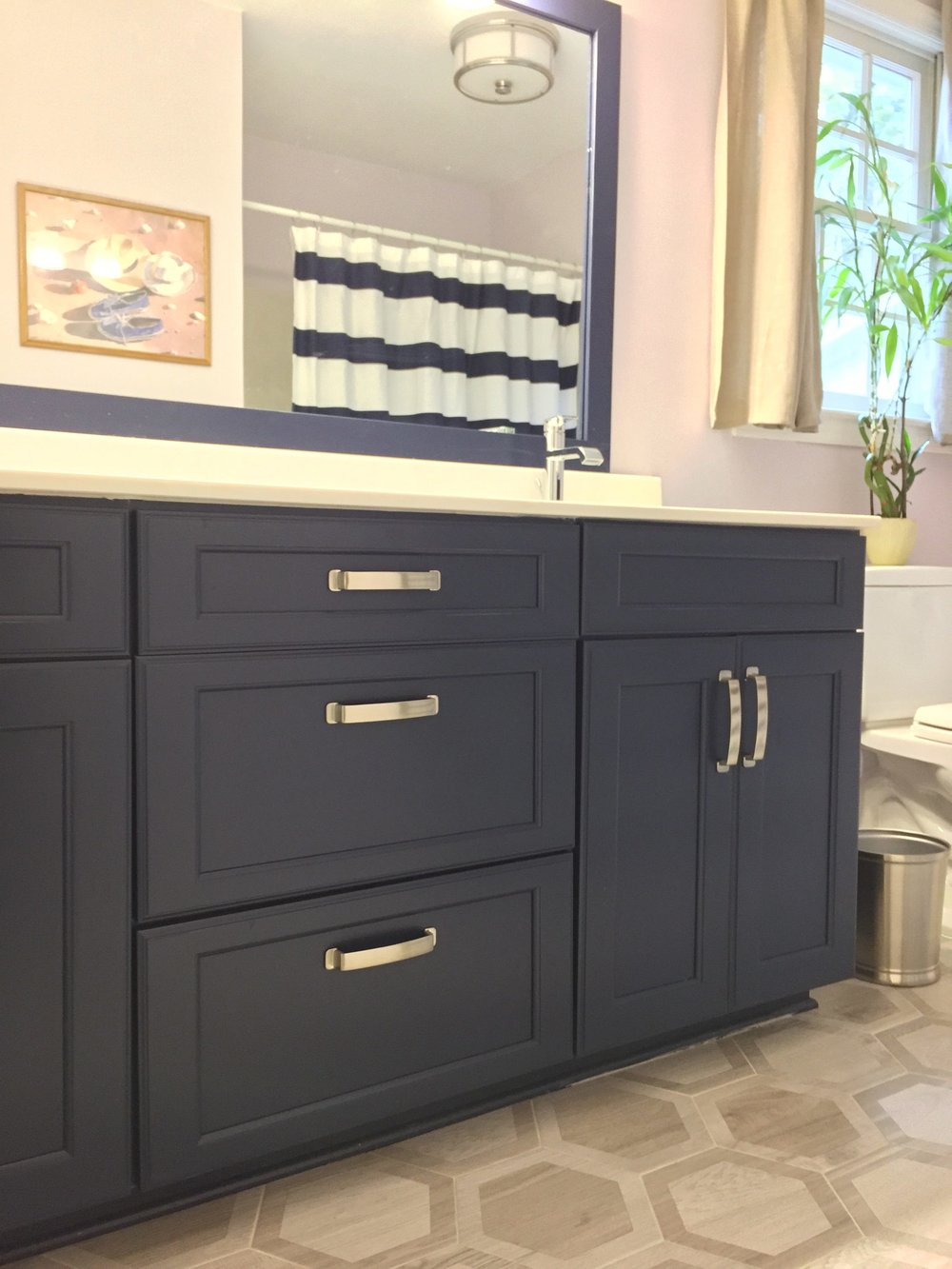 Navy blue cabinets are just plain fun to look at! And very handsome! And look at that floor!