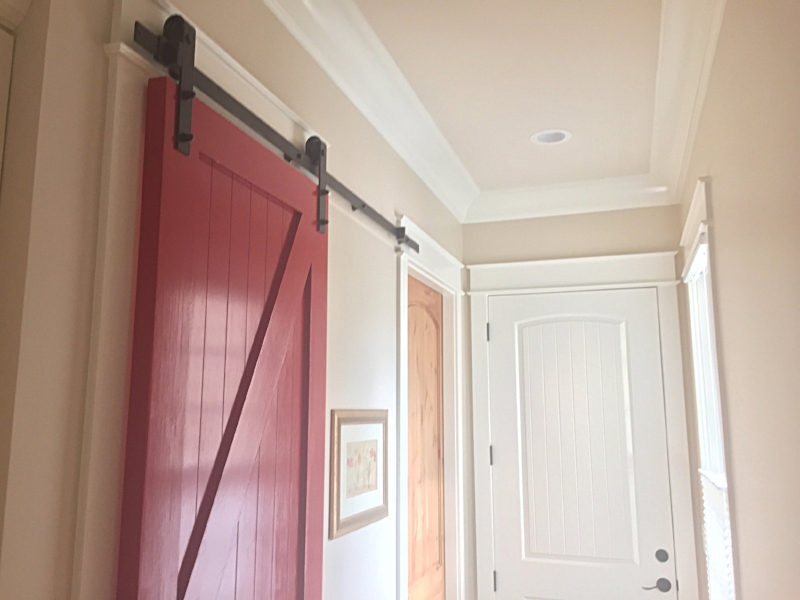 A red barn door at the pantry entrance is a unique touch! Consultations often result in lots of ideas like this one.