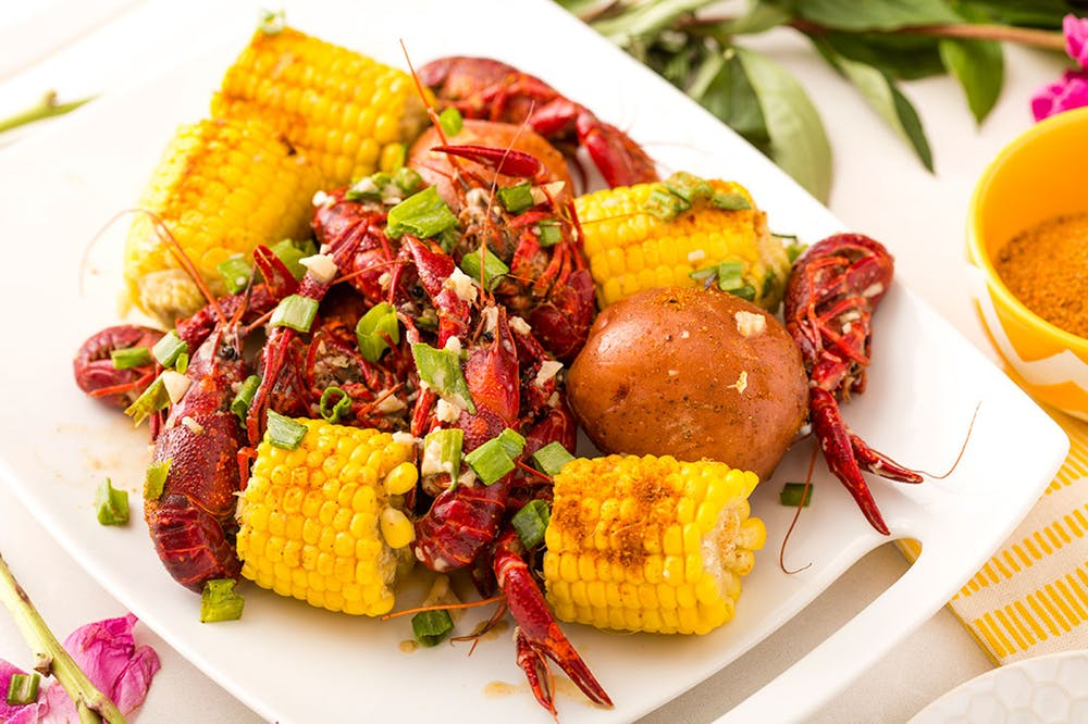 Pinch Signature Boil (20+ guests) - Whether you're celebrating a birthday, or watching the big game, this is the perfect way to experience a classic Viet-Cajun seafood boil. Choose from a selection of fresh, seasonal seafood, and we'll boil it up for you! Each Signature Boil comes with: your choice of spice and sauce — OG Garlic Butter, Coconut Curry, or Dragon, and includes all our boil sides — potato, corn & sausage.Starts at $15-$20/person. Service charge/Utensil fee not included.