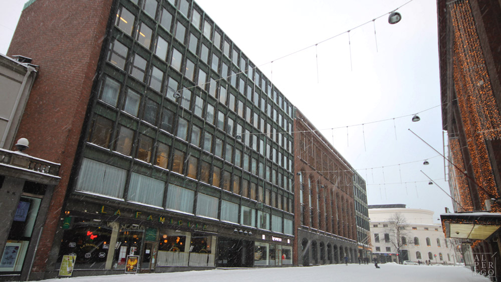 The Rautatalo Office Building  nearby,  Academic Bookshop  in the distance on the corner (both by A. Aalto) and  the City Center Offices  by Eliel Saarinen between them.
