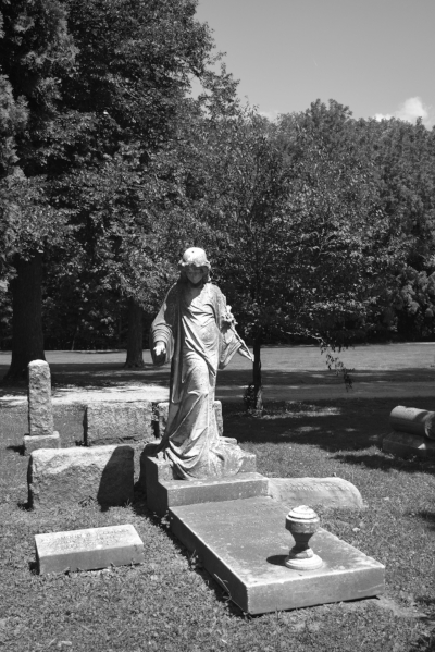 This is the angel statue to the right of the Dimick gravesite. (And don't worry, there will be more posts coming exploring some of the other gravestones at Chippiannock!)