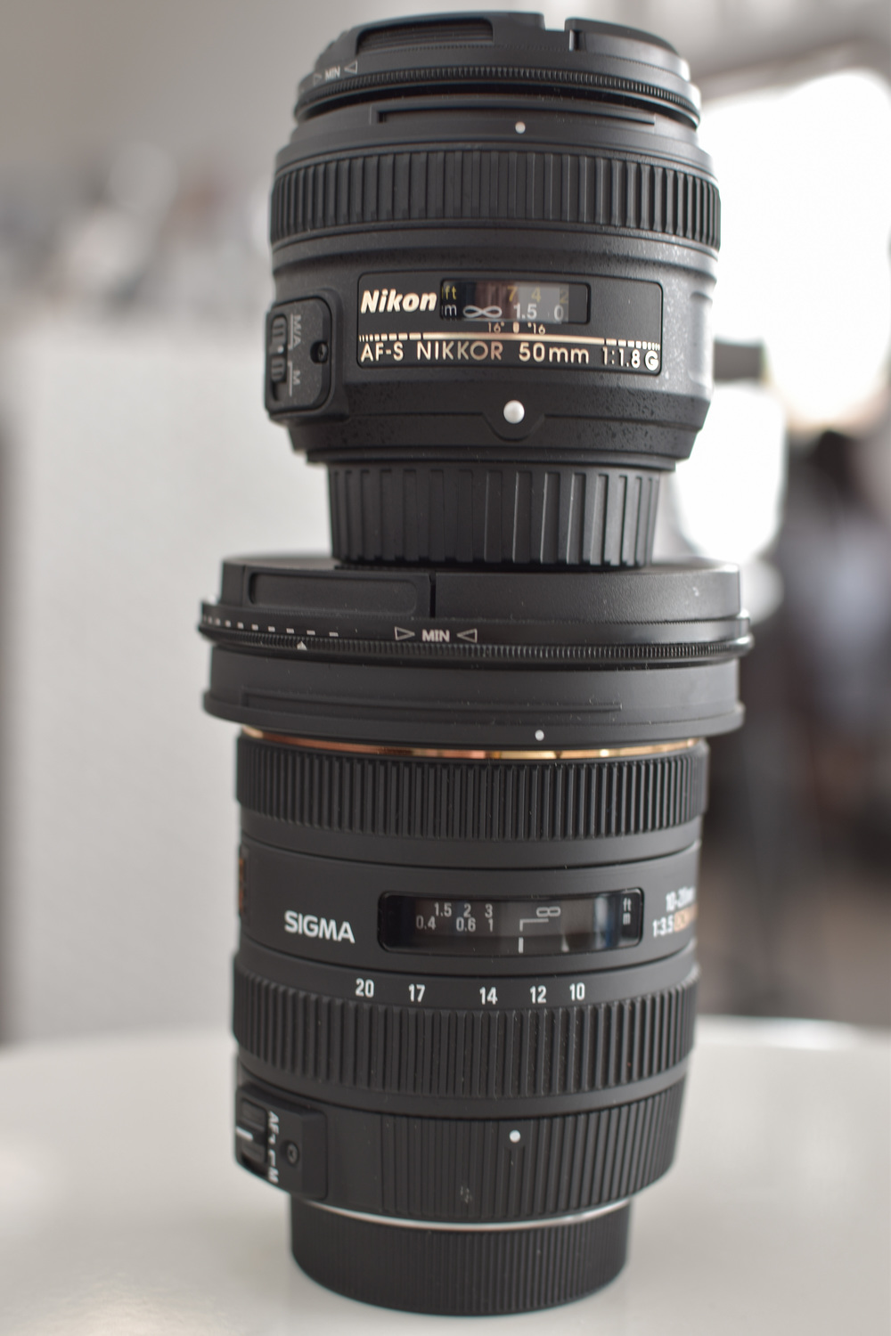 From top to bottom: Nikon Nikkor 50mm 1.8 G and Sigma 10-20 3.5 - Both purchased June, 2016