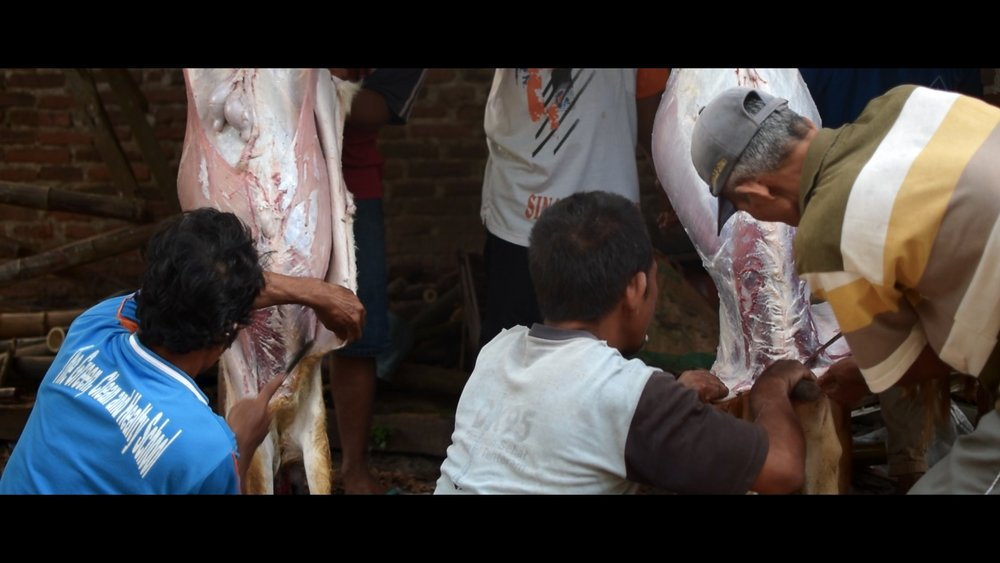 Another still image of the meat preparation.
